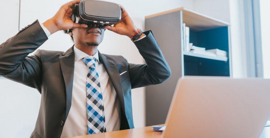 Businessman using virtual reality glasses.